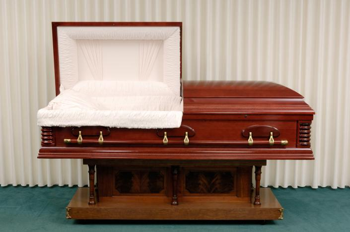 Deep reds, as found with cherry and mahogany, exhibit the natural elegance and style of a wooden casket.